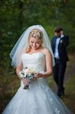 Bride and groom posing together outdoors Stock Photo