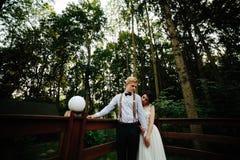 Bride and groom posing on the verandah Stock Image
