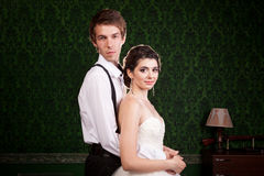 Bride and groom posing in vintage room. Luxury and elegance Stock Image