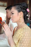Bride and groom pray. With hands clasped in prayer celebrate the marriage of Thailand Stock Image