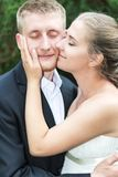 Bride and groom pressed cheeks Stock Photo