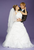 Bride and groom on purple background Stock Image