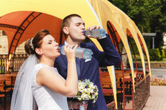 The bride and groom quench thirst Stock Photo