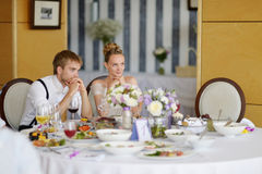 Bride and groom at the reception table Stock Photography