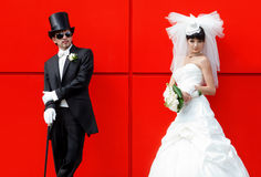Bride and groom on a red background Royalty Free Stock Photography