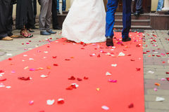 Bride and groom on red carpet royalty free stock image
