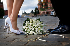 Bride and groom on the Red Square in Moscow. royalty free stock photography