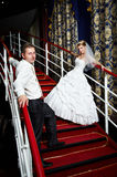 Bride and groom on the red stairs Stock Photos