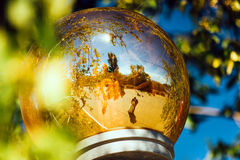 The bride and groom are reflected lamppost.  Royalty Free Stock Photography