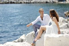 Bride and groom relaxing near sea after wedding, Naples, Italy Stock Images