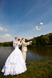 Bride and groom release wedding pigeons. Bride and groom release wedding doves for luck Royalty Free Stock Images