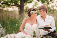 The bride and groom are resting on the nature Royalty Free Stock Photos