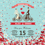 Bride and groom on Reto bicycle.Hearts,flowers background Stock Image