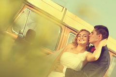 Bride and groom with a retro bus royalty free stock photo