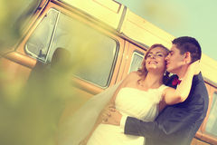 Bride and groom with a retro bus royalty free stock images