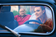 Bride and groom in a retro car Royalty Free Stock Photo