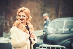 The bride and groom at retro car. Wedding stock photography