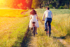 Bride and groom ride bicycles Royalty Free Stock Photography