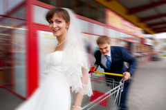 Bride and groom riding on cart Royalty Free Stock Image