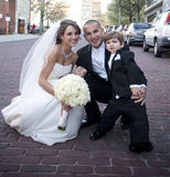 Bride and Groom with Ring Bearer. Photograph of a bride and groom posing with their ring bearer stock images