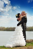 Bride and groom on the river Stock Photography