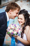 The bride and groom are rolled with laughter Stock Photo