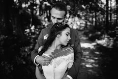 Bride and groom romantic embrace Royalty Free Stock Image