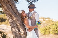 Bride and groom on a romantic moment on nature. Stylish wedding couple outdoors.  Royalty Free Stock Photos