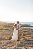 Bride and groom on a romantic moment on nature. Stylish wedding couple outdoors.  Royalty Free Stock Image