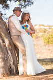 Bride and groom on a romantic moment on nature. Stylish wedding couple outdoors.  Royalty Free Stock Images