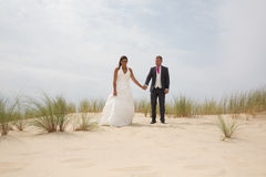 Bride and groom on a romantic moment walking Royalty Free Stock Photography