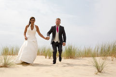Bride and groom on a romantic moment walking Royalty Free Stock Images