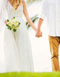 Bride and Groom, Romantic Newly Married Couple Holding Hands, Ju Stock Image