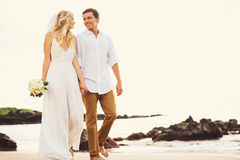 Bride and Groom, Romantic Newly Married Couple Holding Hands Wal. King on the Beach, Just Married Stock Photo