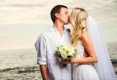Bride and Groom, Romantic Newly Married Couple Kissing at the Be. Ach, Just Married Stock Photography