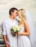 Bride and Groom, Romantic Newly Married Couple Kissing at the Be. Ach, Just Married Royalty Free Stock Image