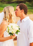 Bride and Groom, Romantic Newly Married Couple Kissing at the Be. Ach, Just Married Royalty Free Stock Photos