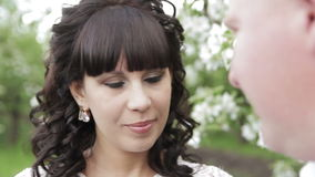 Bride and groom a romantic walk in the apple orchard stock video footage