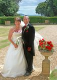 Bride and Groom with Roses. Bride and Groom in the countryside with Roses Royalty Free Stock Images