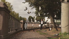 Bride and Groom Run Through the Pigeons. Wedding Couple Bride and Groom Run Through the Pigeons at the Embankment stock video