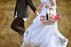Bride and groom running Royalty Free Stock Photos