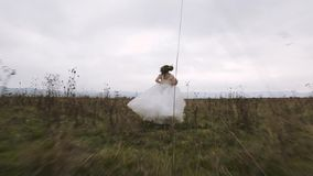 Bride from the Groom Runs. Stedicam shot. Bride from the Groom Runs. Slow motion stock video