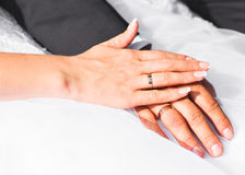 Bride and groom's arms with rings Stock Photo
