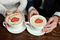 Bride and groom`s Coffee time, coffee break.Cups with hearts stock photos