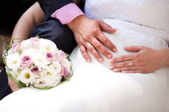 Bride and groom's hands - Expecting baby Royalty Free Stock Photo