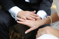 Bride and groom's hands with the wedding rings Stock Photo