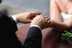 Bride and groom's hands with the wedding rings Royalty Free Stock Image