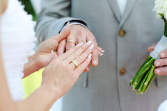 Bride and groom's hands with wedding rings Stock Photo