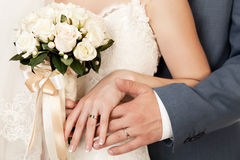 Bride and groom's hands. With wedding rings Stock Photo