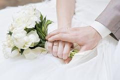 Bride and groom's hands Stock Photography